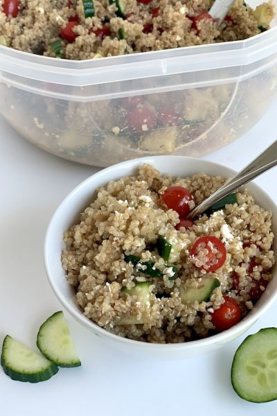 healthy nutritious quinoa salad with cucumbers tomatoes and balsamic vinagrette