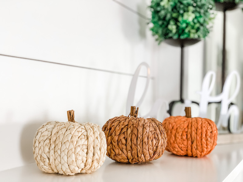 knitted sweater texture on fall pumpkin decor for a simple fall farmhouse mantle