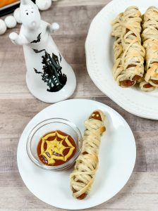 Halloween mummy dog with spiderweb dipping sauce