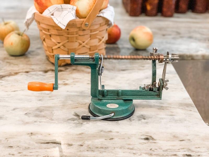An apple peeler/corer/slicer makes fast work of peeling a ton of apples for homemade applesauce