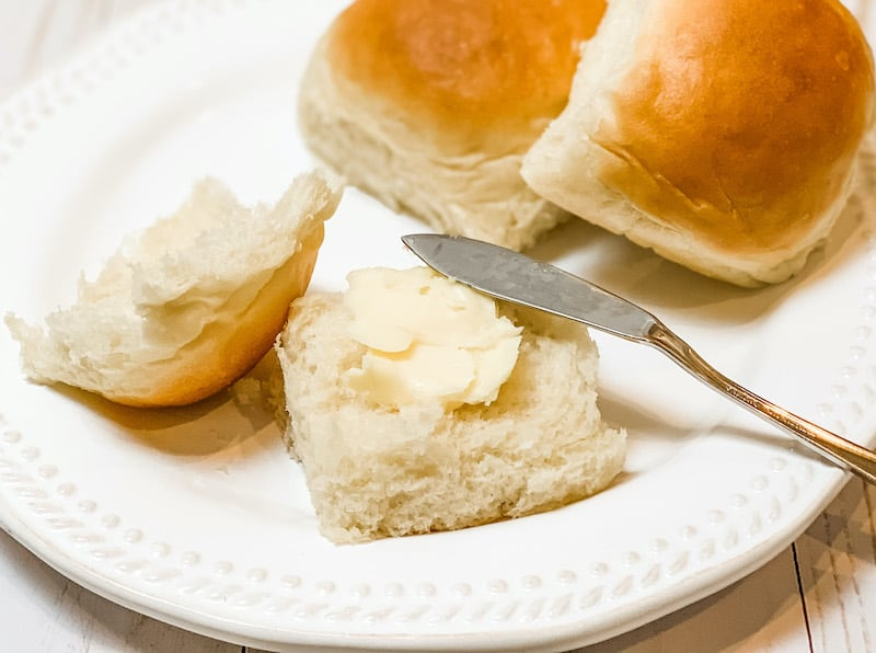 soft and fluffy dinner rolls with butter on top