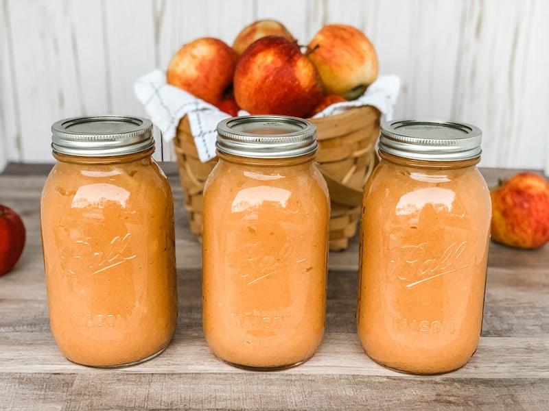 Homemade applesauce in quart mason jars