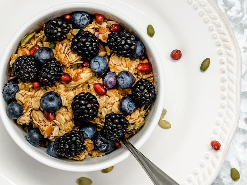 Blackberries, blueberries, and pomegranate on homemade granola